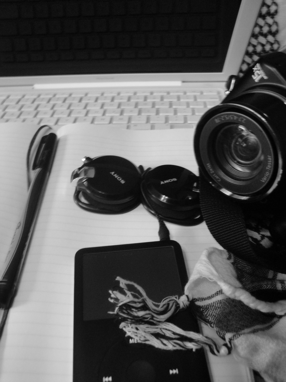 pen and paper and a camera interacting with my laptop